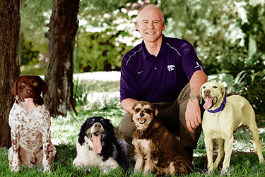 Dean Richardson shares a casual moment with his family's dogs: Jack (GSHP), Jake (French Brittany), Rudy (schnoodle) and Ike (English pointer)