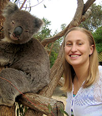 Dr. Michelle Mazur has fun with a Koala in Australia