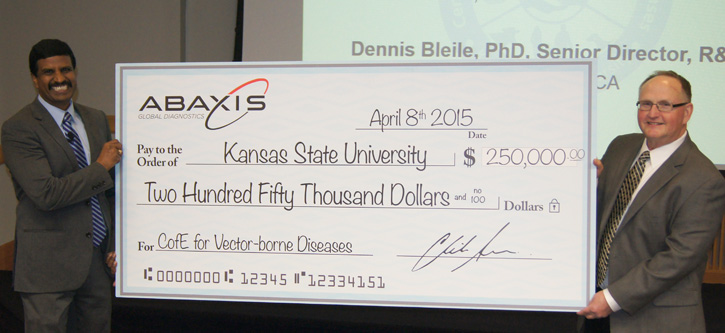 Dr. Roman Ganta accepts check from Abaxis' Dr. Dennis Bleile