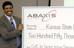 Dr. Roman Ganta accepts check from Abaxis
