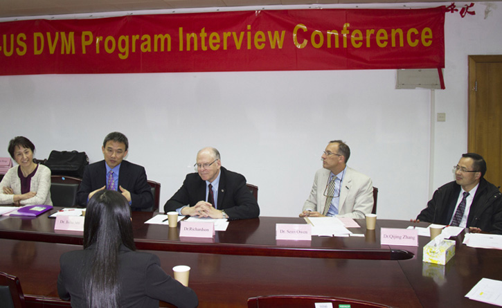 The committee interviews an applicant in China