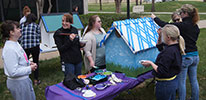 Students decorate dog house