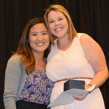 Fourth-year student Michelle Chen, left, presents Dr. Jeni Nezerka with the Bayer Excellence in Communication Award at the senior honors banquet.