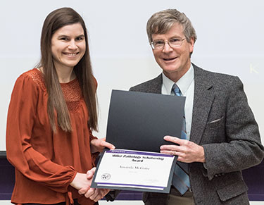 Amanda McGuire receives the Miller Pathology Scholarship from Dr. Derek Mosier.