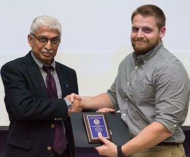 Dr. M.M. Chengappa presents the ASR Ganta Award to Kayd Byers.