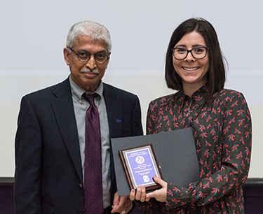 Dr. M.M. Chengappa presents the ASR Ganta Award to Victoria DiCiccio