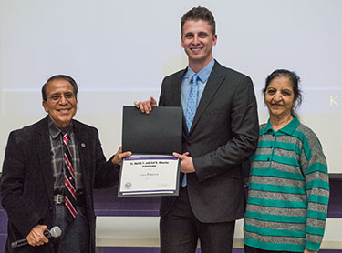 Dr. Harish and Ved Minocha present their namesake scholarship to Luca Popescu.