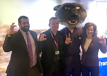Omar Farias, Dr. Jolle Kirpensteijn, Willie the Wildcat and Dr. Bonnie Rush