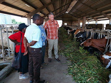 Dr. Charles Dodd tours the university dairy farm