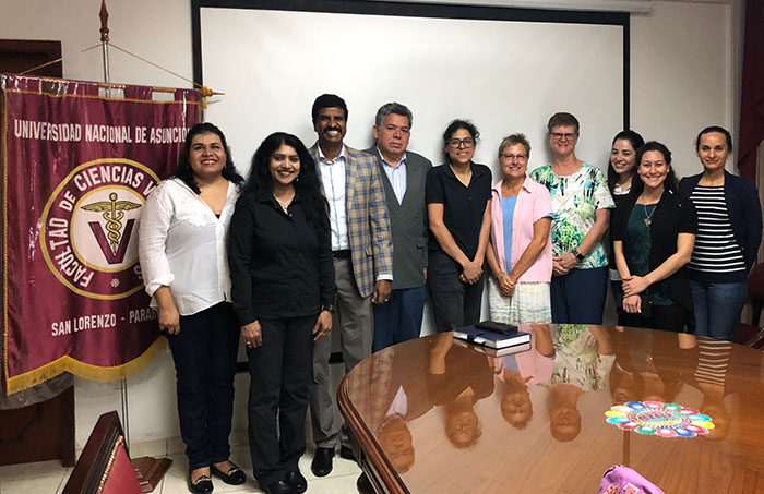 Meeting the Associate Dean of the FCV-UNA and other researchers. From left to right: Raquel Pedrozo, DVM, MSc, Head of the Clinical Sciences Division, Department of Pathology and Clinics FCV –UNA; Suhasini Ganta, BSc, KSVDL, CVM-KSU, Roman Ganta, MSc, PhD, Director of the Center of Excellence for Vector-Borne Diseases, CVM-KSU; Shyrley Paola Amarilla, DVM, MSc, PhD, Head of the Anatomic Pathology Division, Department of Pathology and Clinics FCV-UNA, Carlos Ramon Chirife, DVM, Associate Dean FCV-UNA, Melinda Wilkerson, DVM, PhD, Head SGU, Grenada, Adjunct Professor, KSU; Andrea Blair, MEd, Director of Student Accessibility and Accommodation Service, SGU, Sandra Perez Macchi, DVM, MSc, Clinical Pathology Division, Department of Pathology and Clinics, FCV-UNA; Giselle Cino, DVM, PhD, Pathologist at KSVDL; Liz Castro, DVM, MSc, Clinical Sciences Division - Department of Pathology and Clinics FCV -UNA