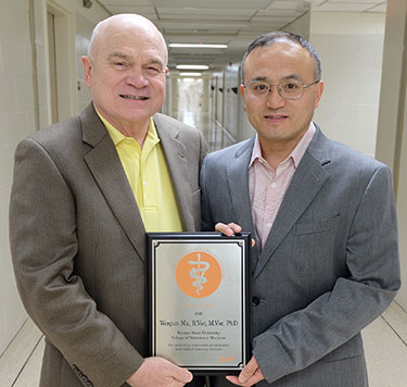 Dr. Frank Blecha and Dr. Wenjun Ma