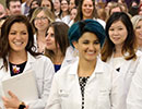 Third-year students greet parents at White Coat Ceremony